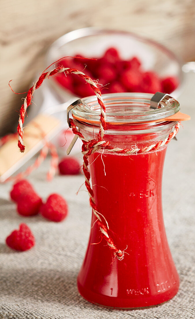 Homemade raspberry limes in a bottle