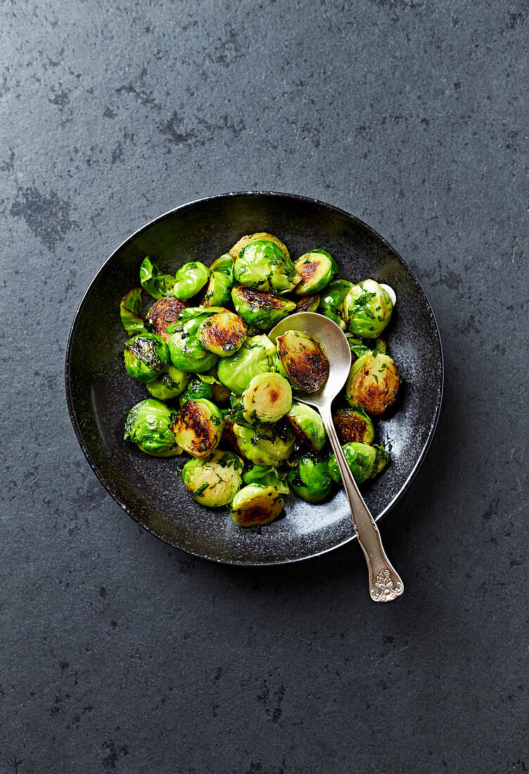 Roasted Brussels Sprout with Parsley on a plate