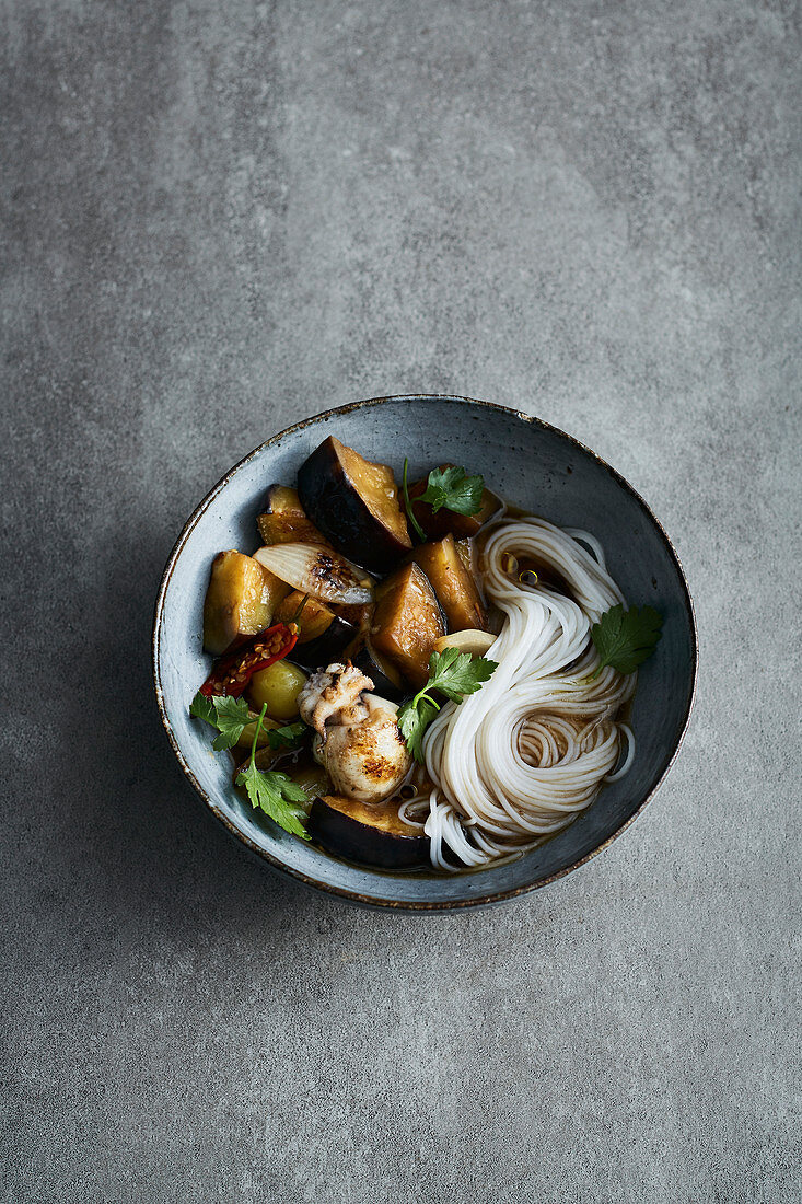Oriental aubergine stew with rice noodles and sepia