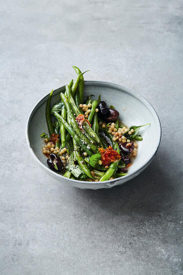 Fregola sarde with Blauhilde beans, salami and olives