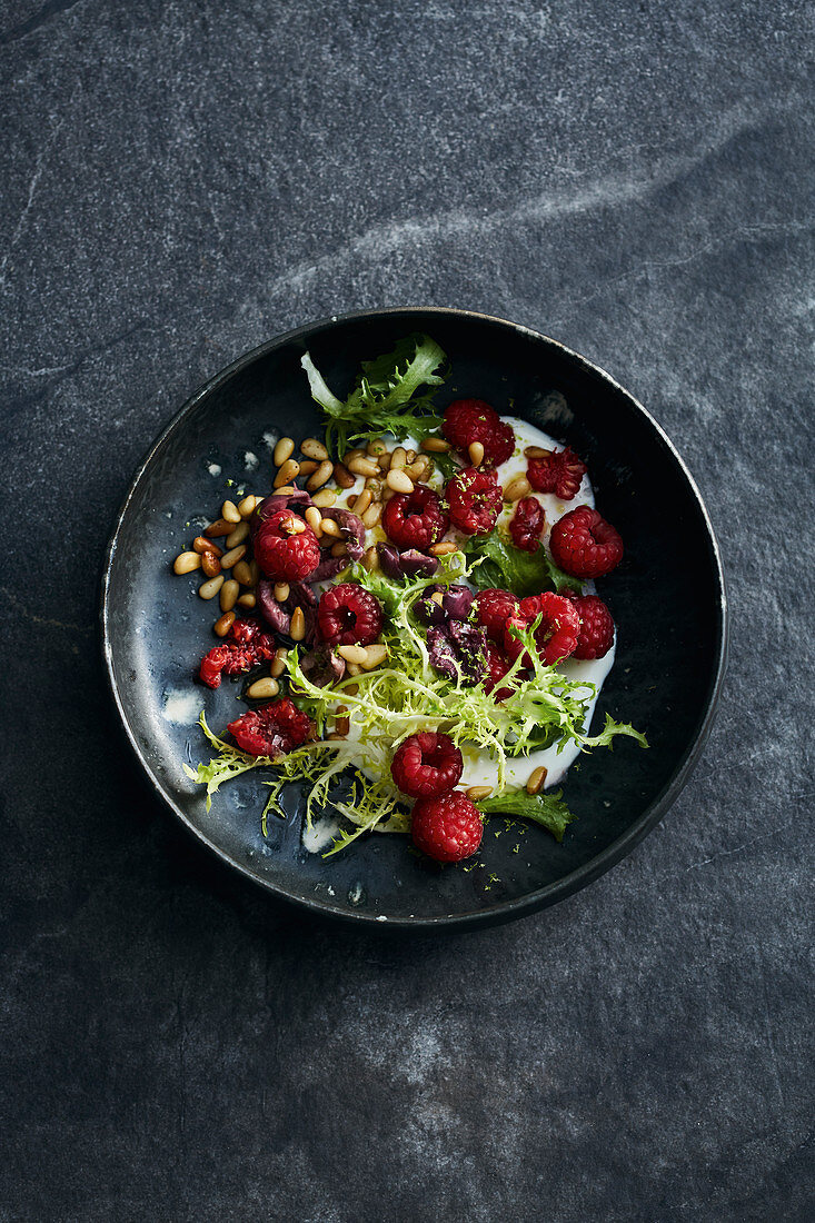 Frisee lettuce with raspberries, olives, sheep's yoghurt and pine nuts