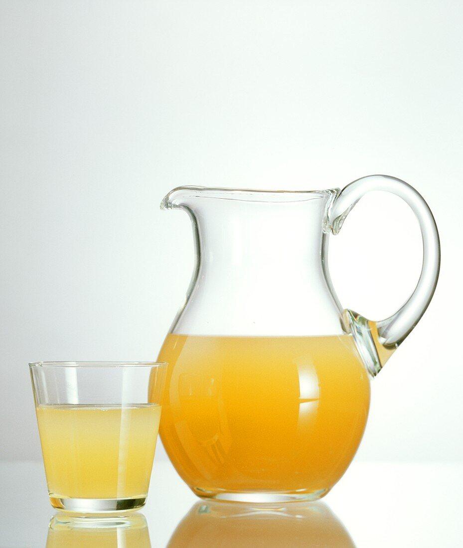Sauerkraut juice in glass and carafe