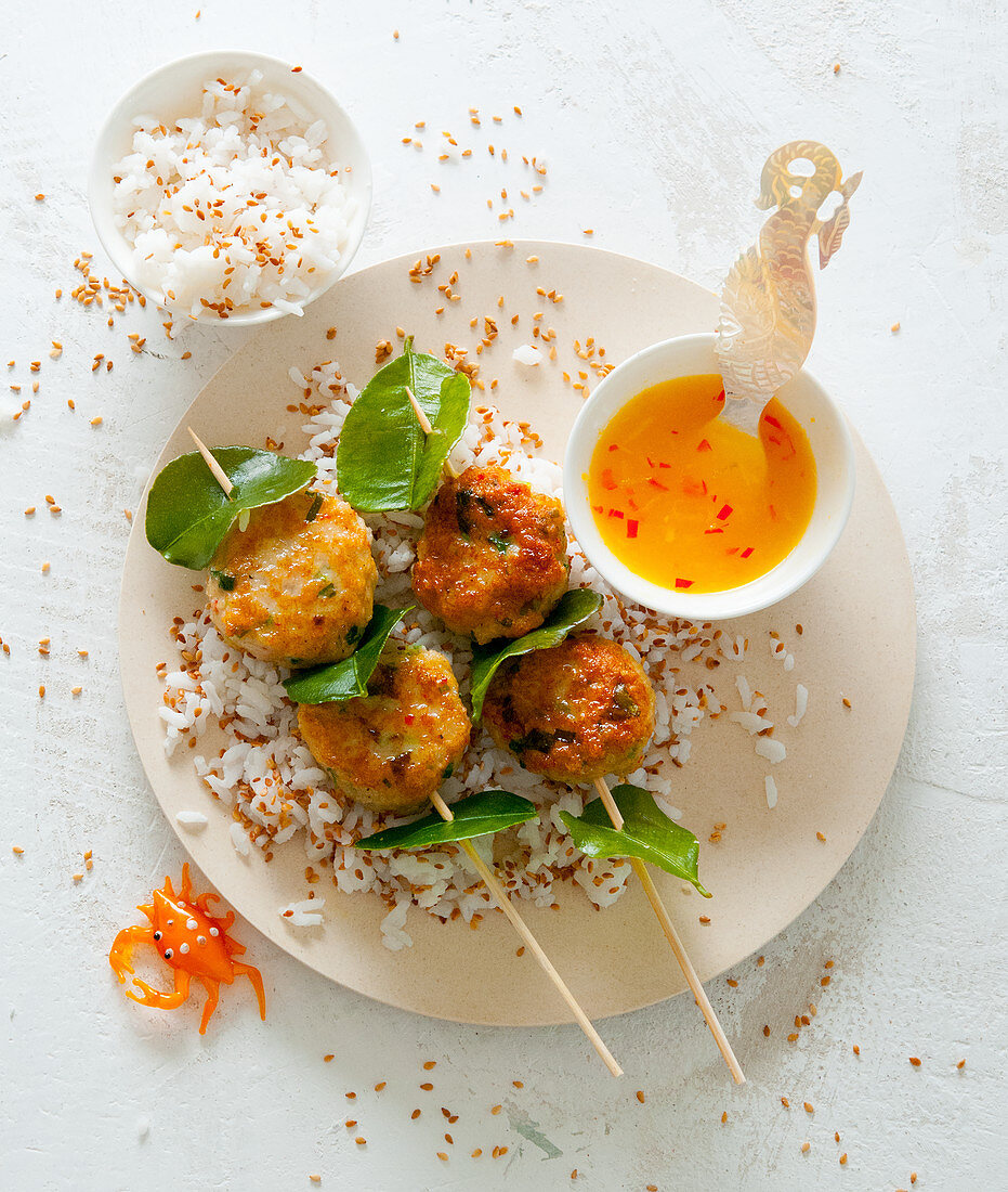 Crab meatballs with kaffir lime leaves, an orange and chilli sauce and aromatic sesame seed rice