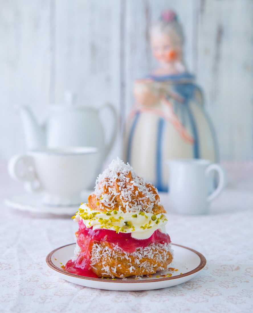 A profiterole filled with rhubarb compote and pistachio cream