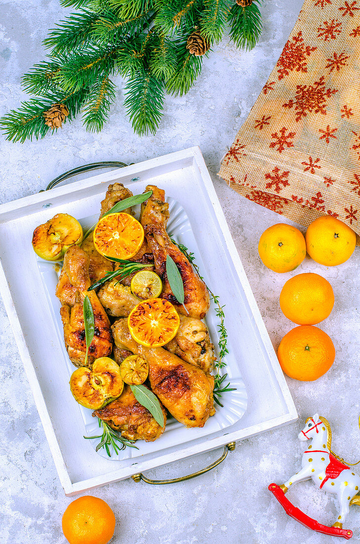 Baked chicken legs in a honey marinade for a Christmas dinner
