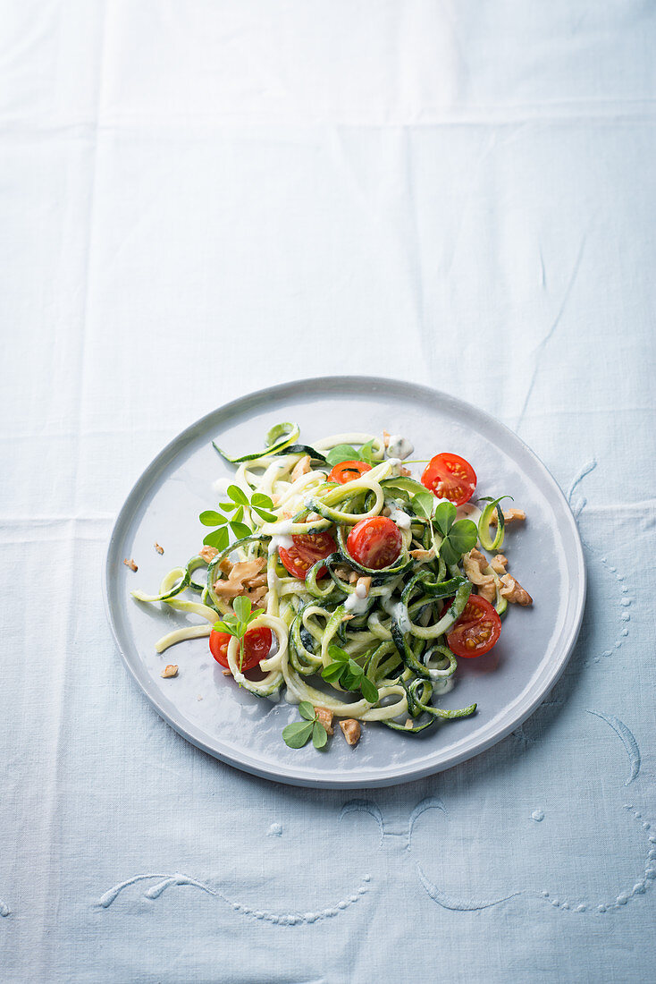Courgette noodles with cherry tomatoes and alfalfa
