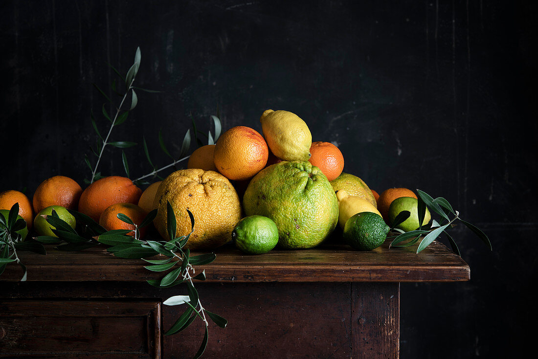 Various citrus fruits on a wooden table