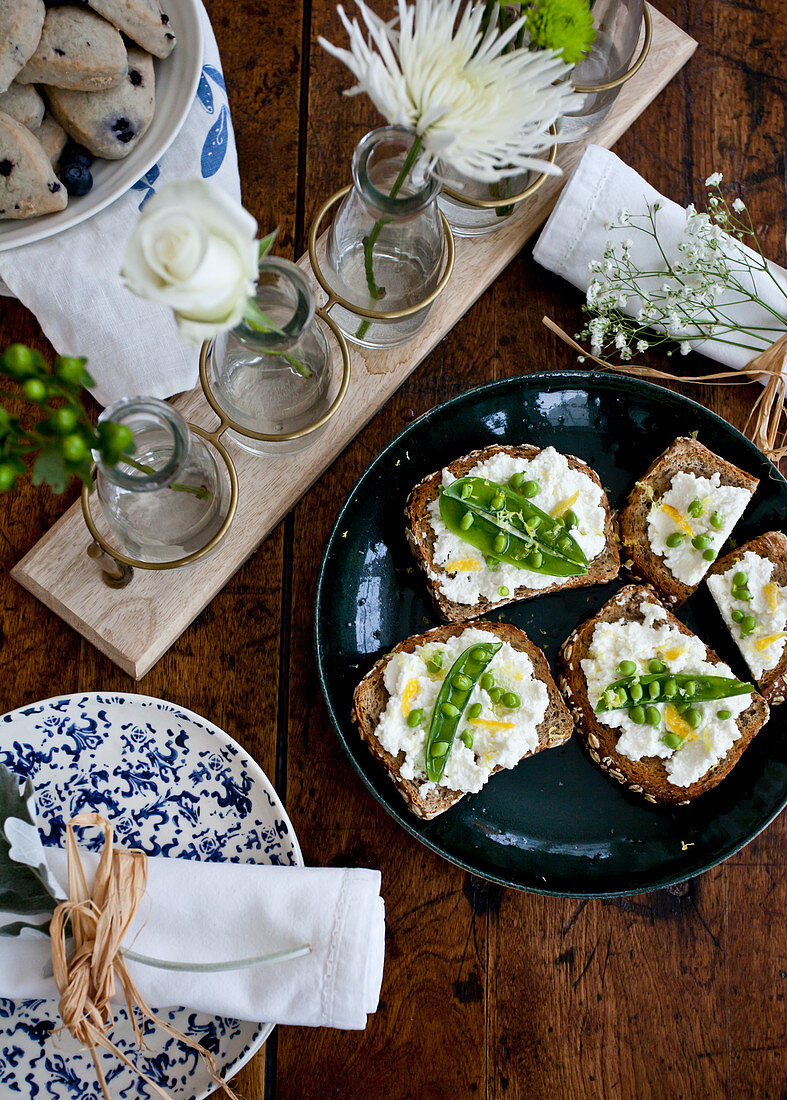 Ricotta toast with peas, lemon zest and olive oil, blueberry scones
