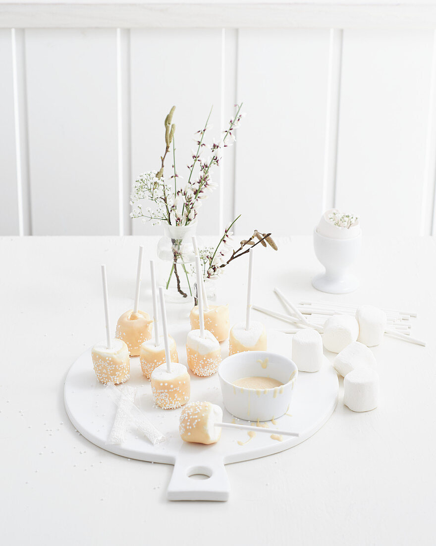Marshmallow pops covered in white chocolate