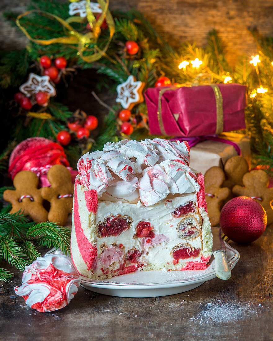 Festive christmas cake with sour cream mousse and strawberry filled profitroles