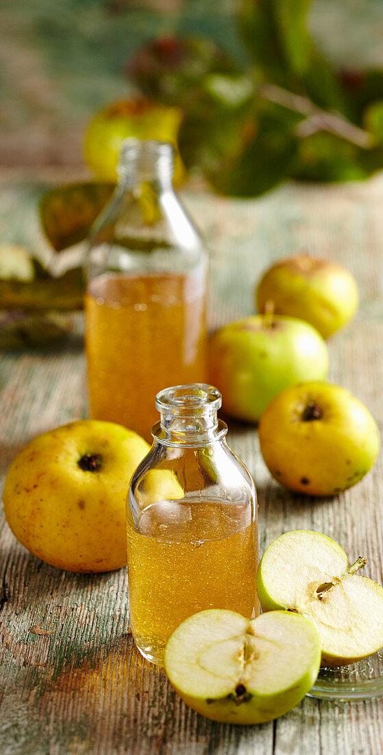Bottles of homemade apple syrup