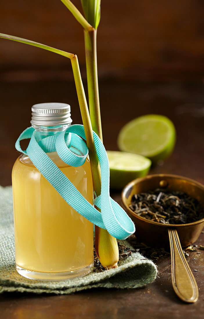 Green tea syrup, limes and lemon grass in a bottle with turquoise ribbon