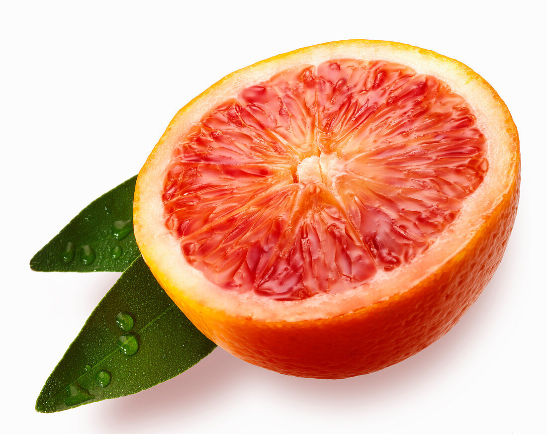 Blood orange half with leaves