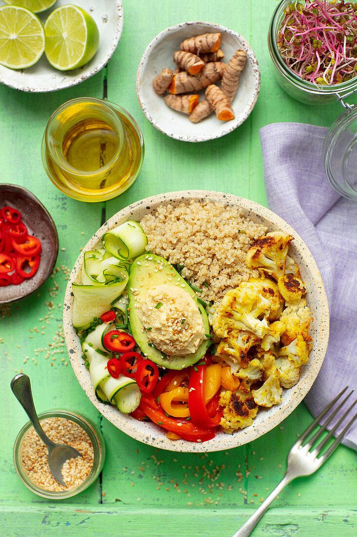 Buddha bowl (vegan) with quinoa, avo, hummus, baked cauliflower and pepper