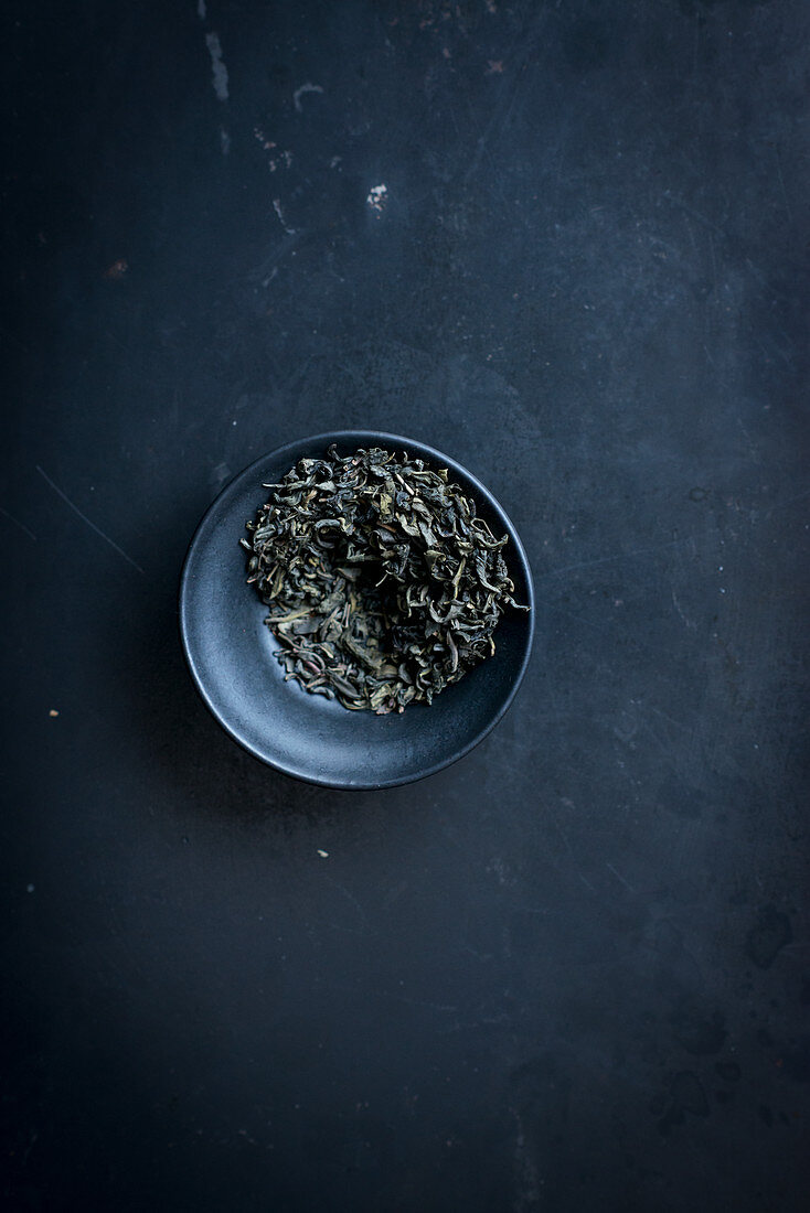 Tea leaves in a small bowl