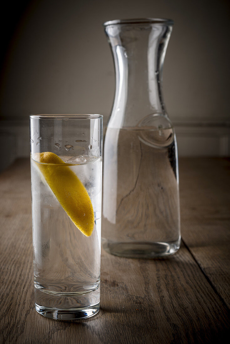Glass of water with lemon wedge