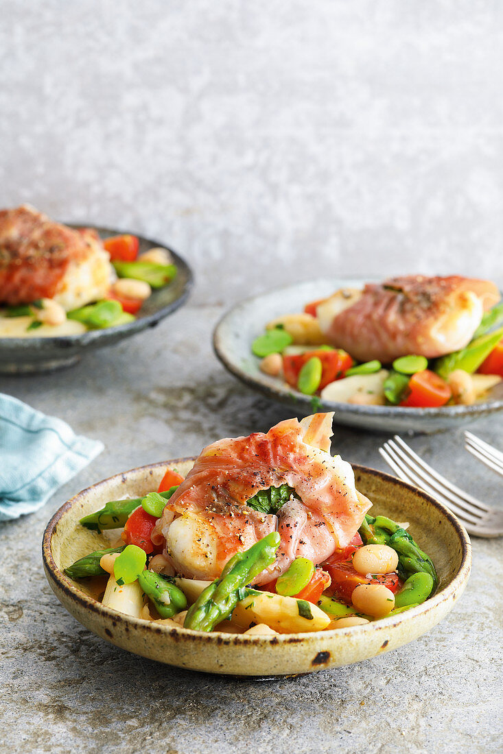 Monkfish saltimbocca with asparagus and bean vegetables