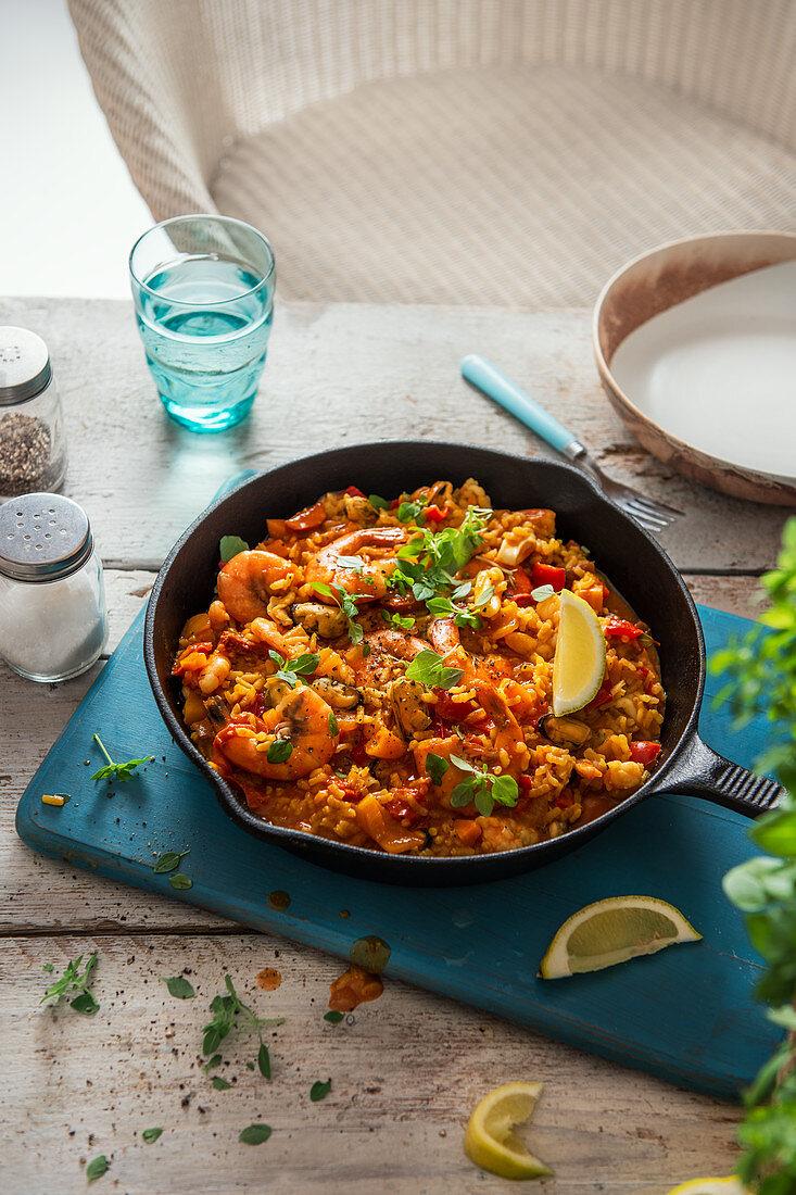 Seafood paella with basil and fresh lemon