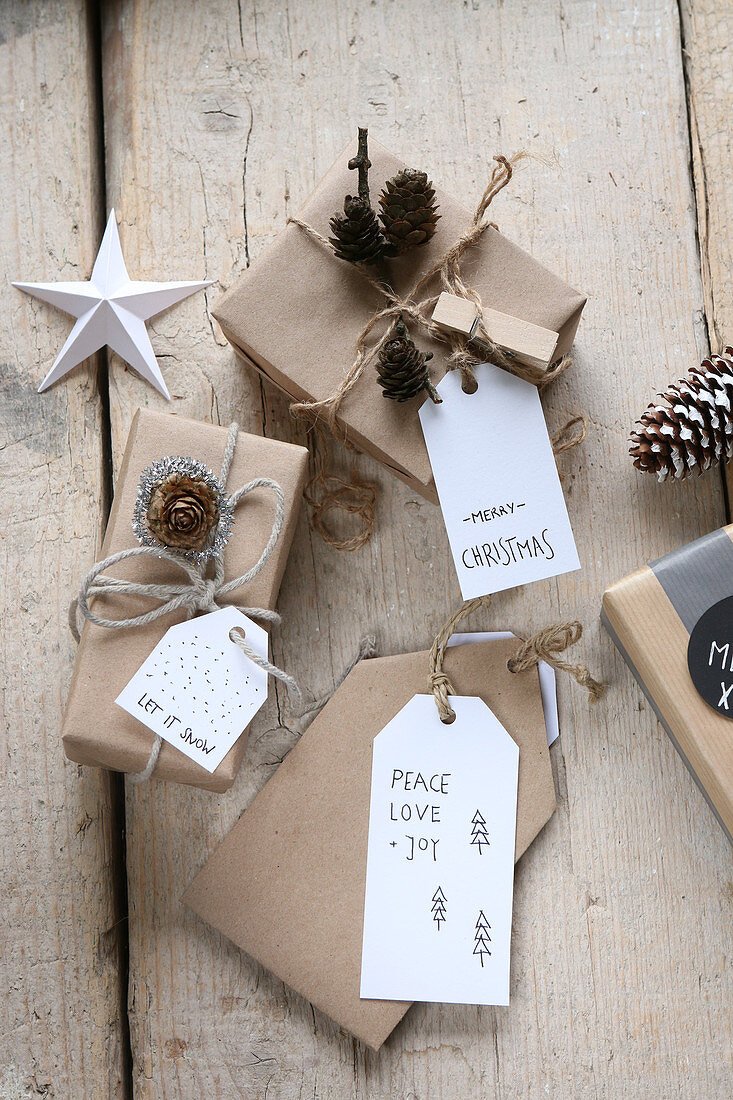 Wrapped Christmas gifts with various labels and messages