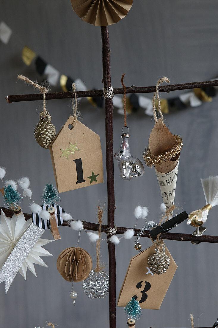 Christmas-tree decorations on stylised tree handmade from twigs
