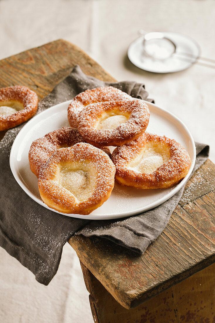 Auszogene (Bavarian-style doughnuts) with sugar on a wooden board