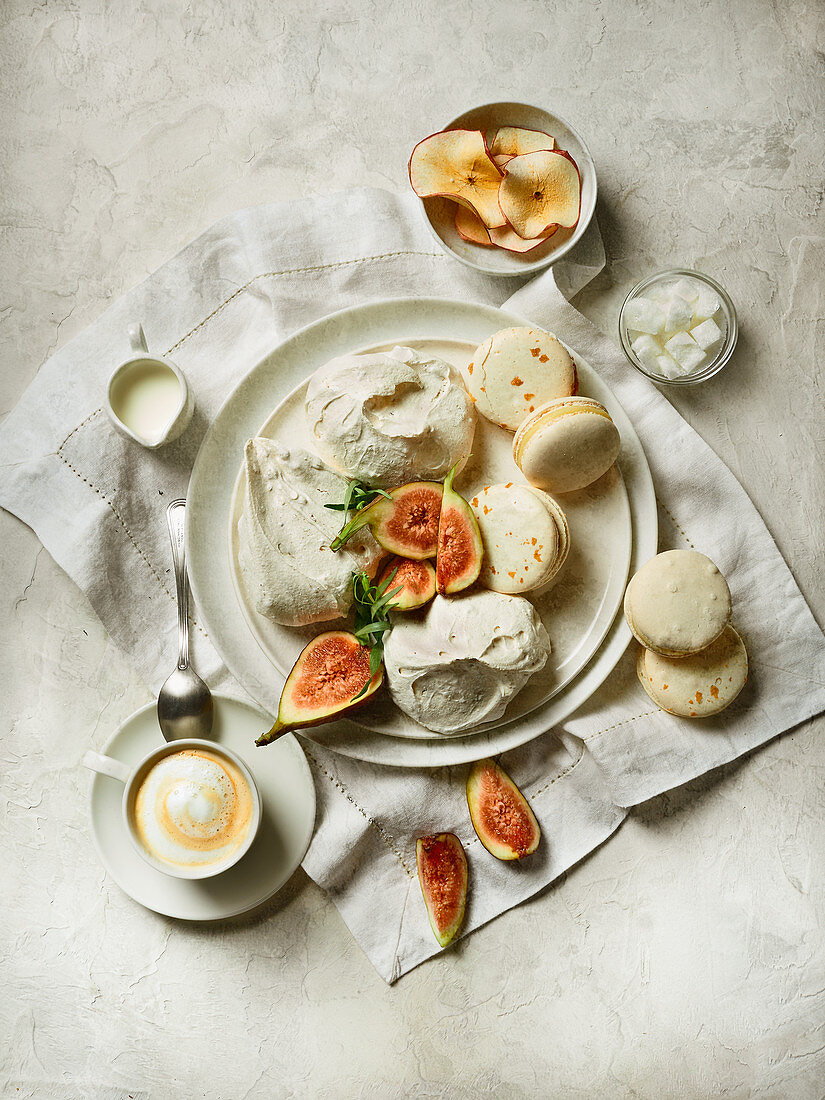 Meringues and macaroons with fresh figs with coffee