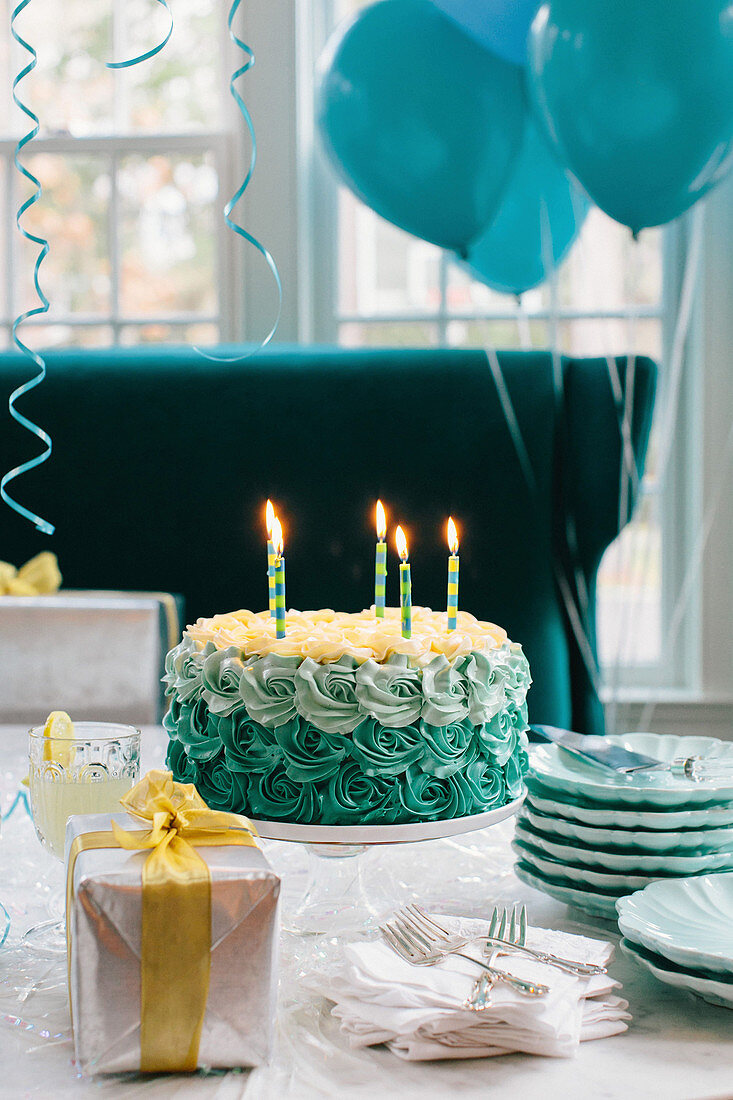 Blue Birthday Cake with Lit Candles