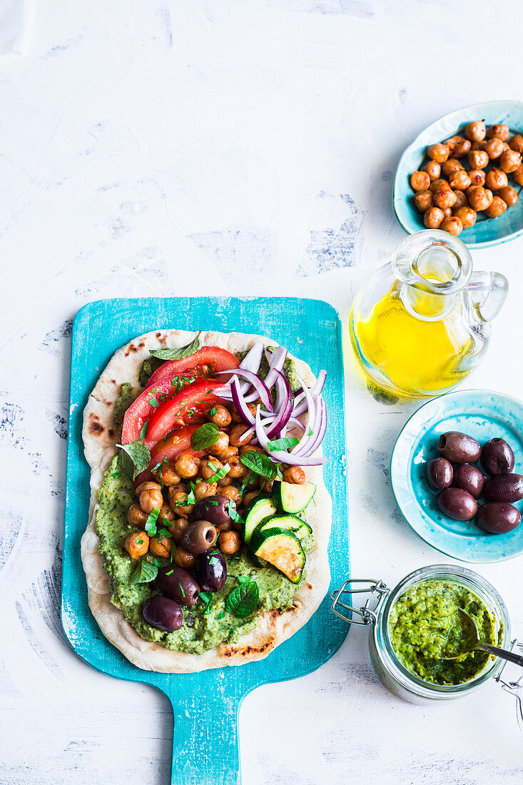 Vegan flat bread with kale hummus and vegetables
