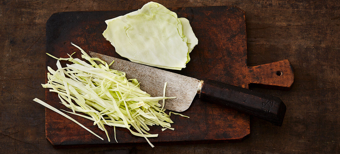 White cabbage being finely sliced