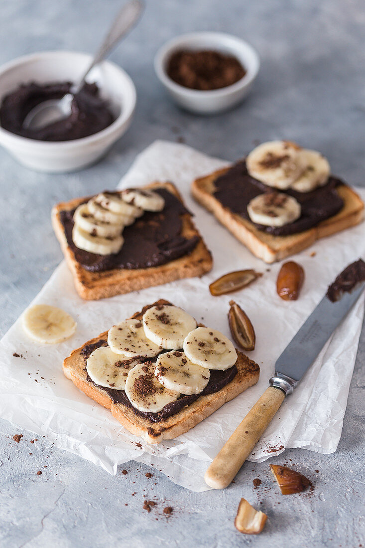 Toasts with vegan chocolate spread and banana slices