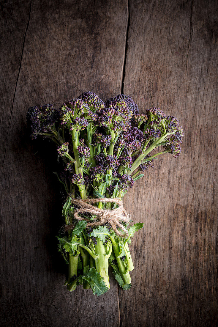 Purple Sprouting Broccoli on Wooden Background