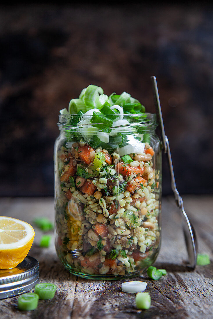 Bulgur salad with red lentils and vegetables