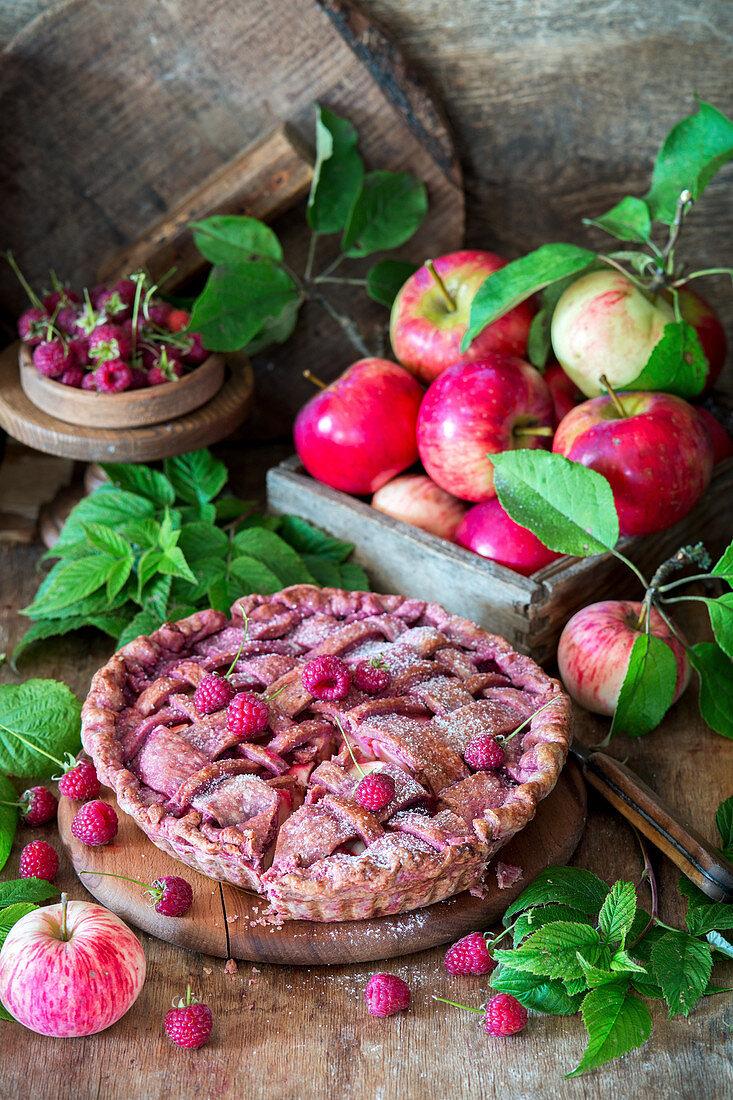 Lattice apple pie with raspberries
