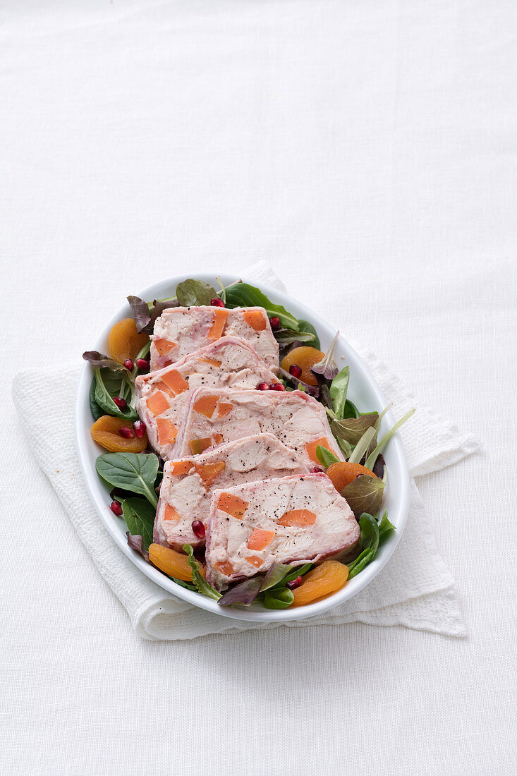Chicken and ham terrine on a bed of salad