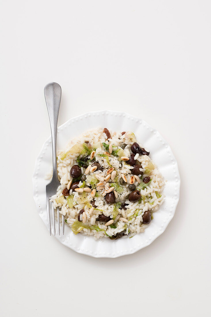 Risotto with endive, olives and pine nuts