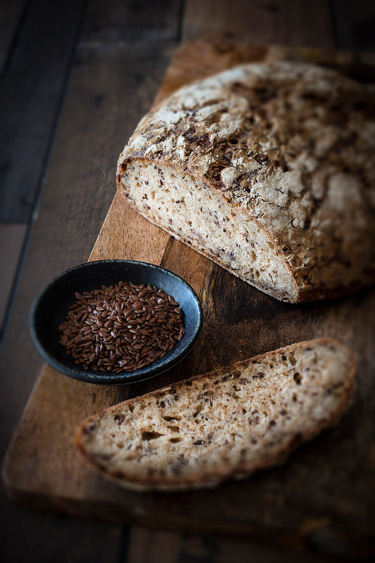 Linseed bread and flax seed on a wooden cutting board