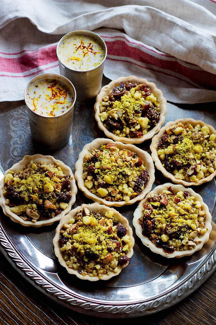 Mawa Gujiya tarts and almond milk Thandai (India)