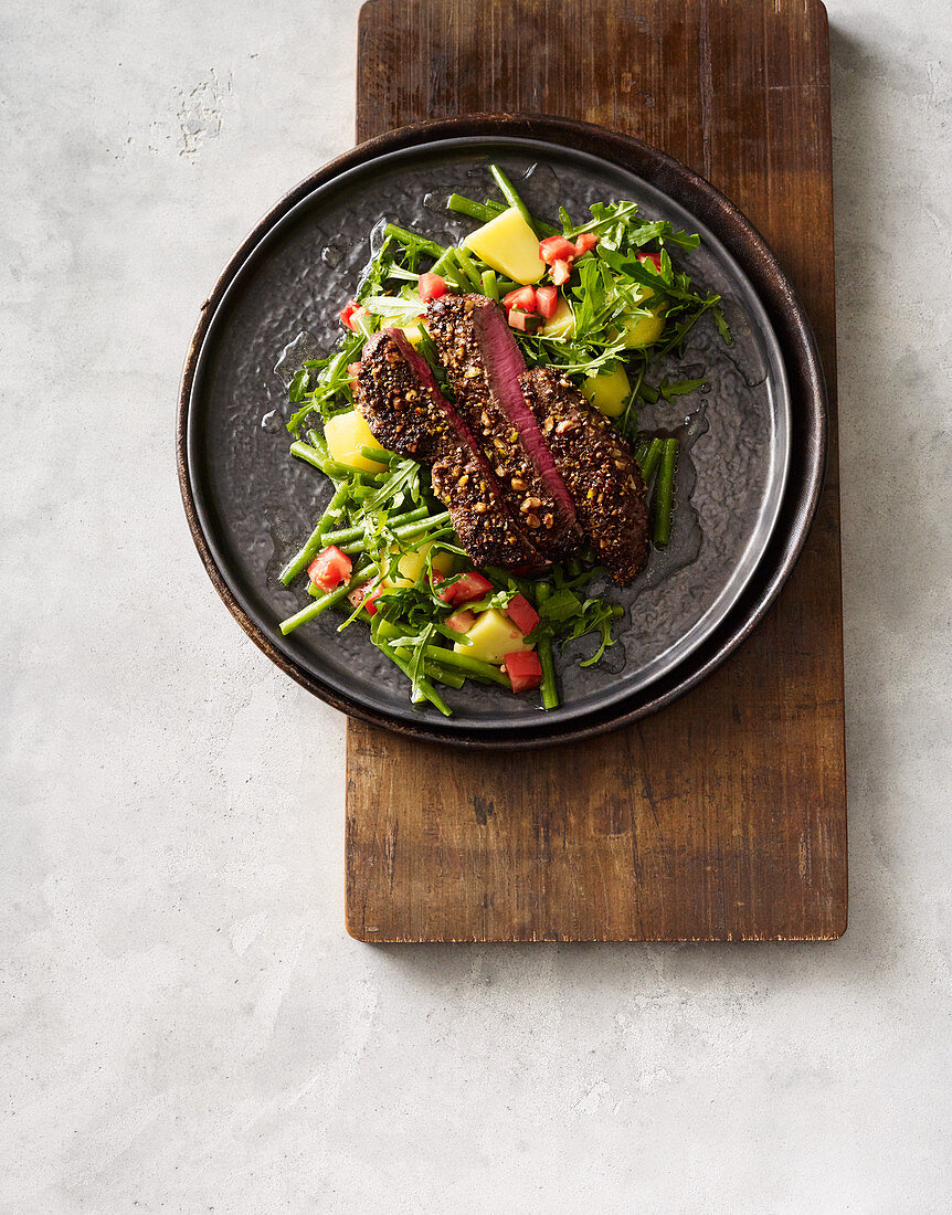Rump steak with a potato and bean salad