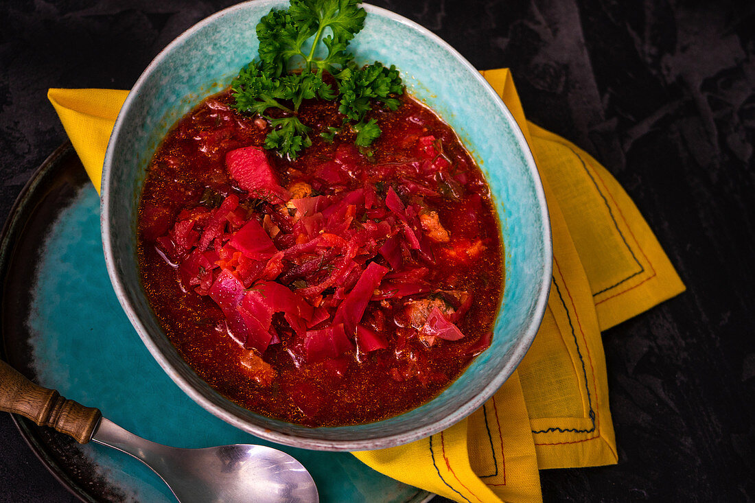 Traditional ukrainian beet soup red borscht on wooden table