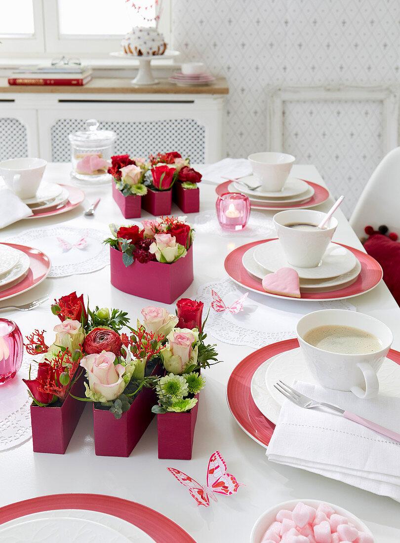 Festively set table with handmade flower arrangements