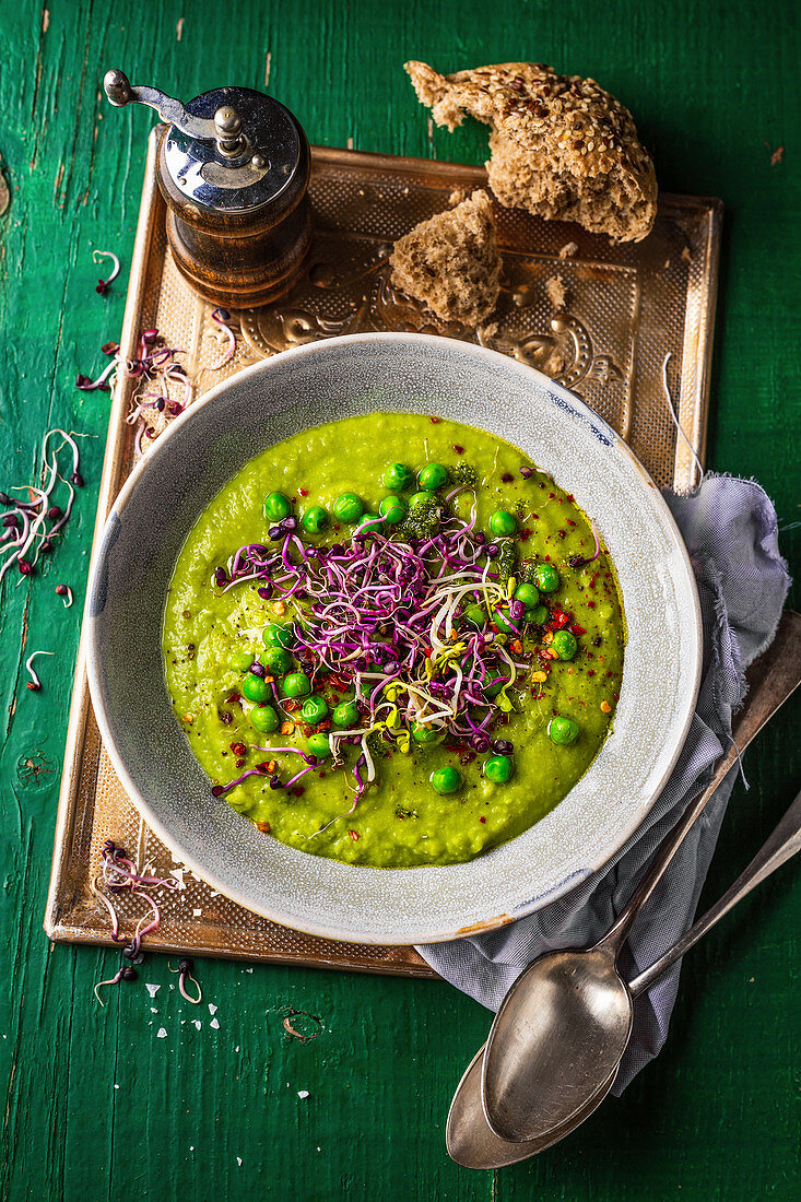 Pureed pea soup with sprouts