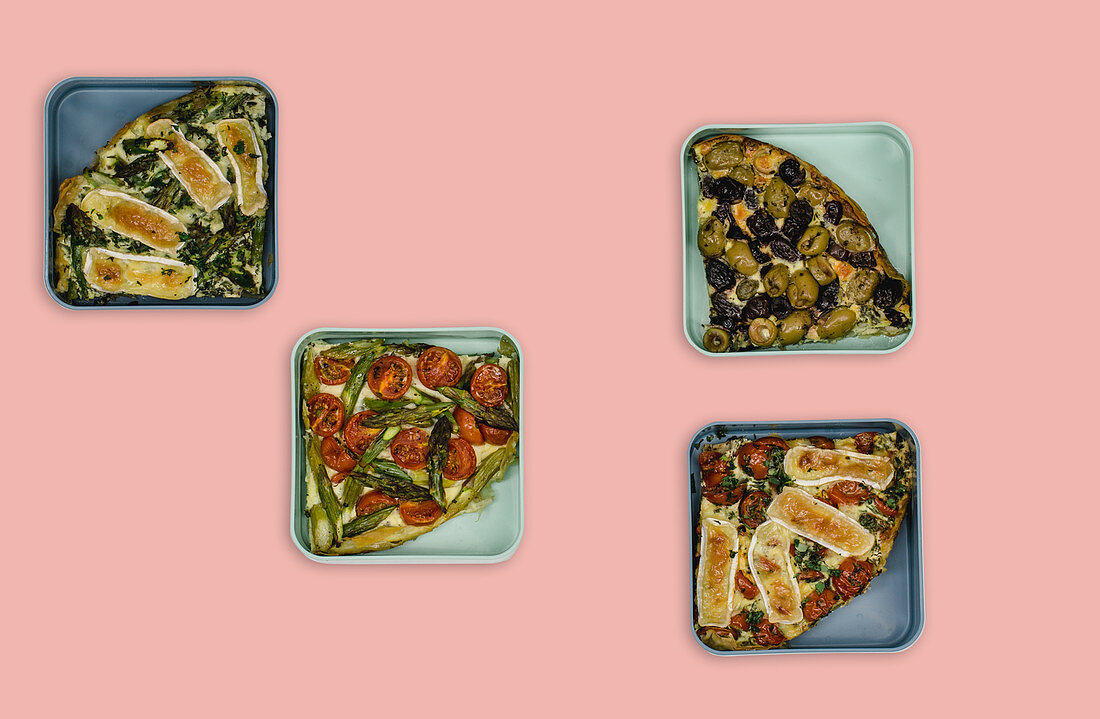 Four types of quiche with camembert, asparagus, tomatoes and olives (meal prep)