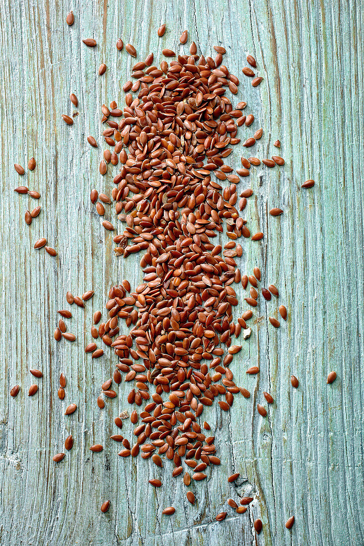 Linseed on a wooden background
