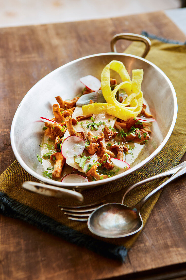 Poached trout with radishes and a chanterelle mushroom salad