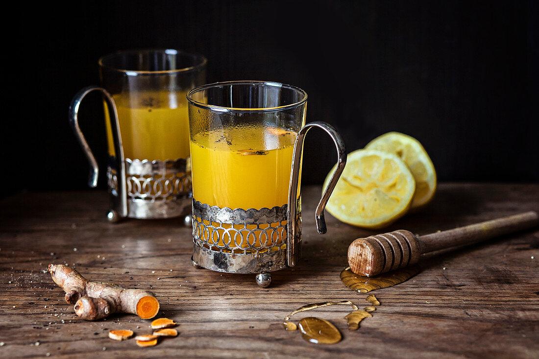 Hot turmeric and lemon tea with honey