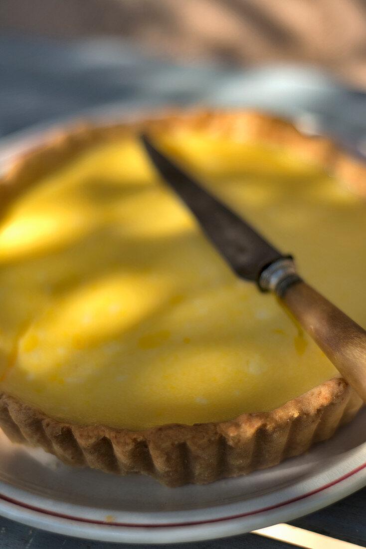 Lemon tart with a knife