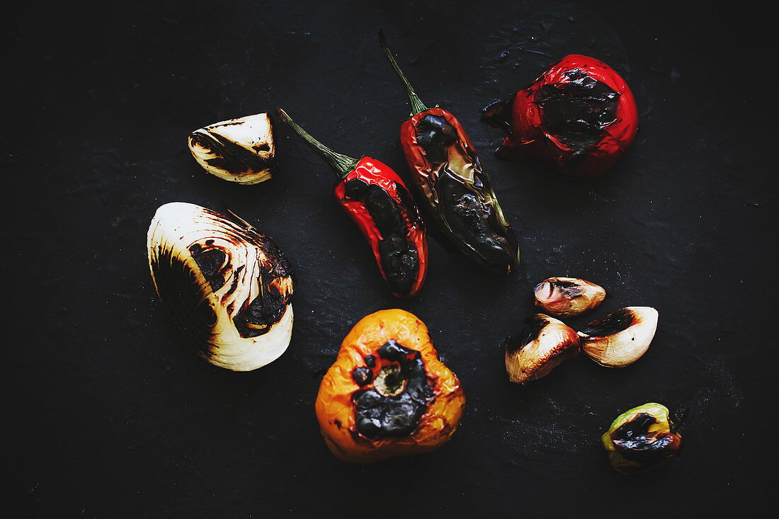 Roasted vegetables placed on black tray in kitchen