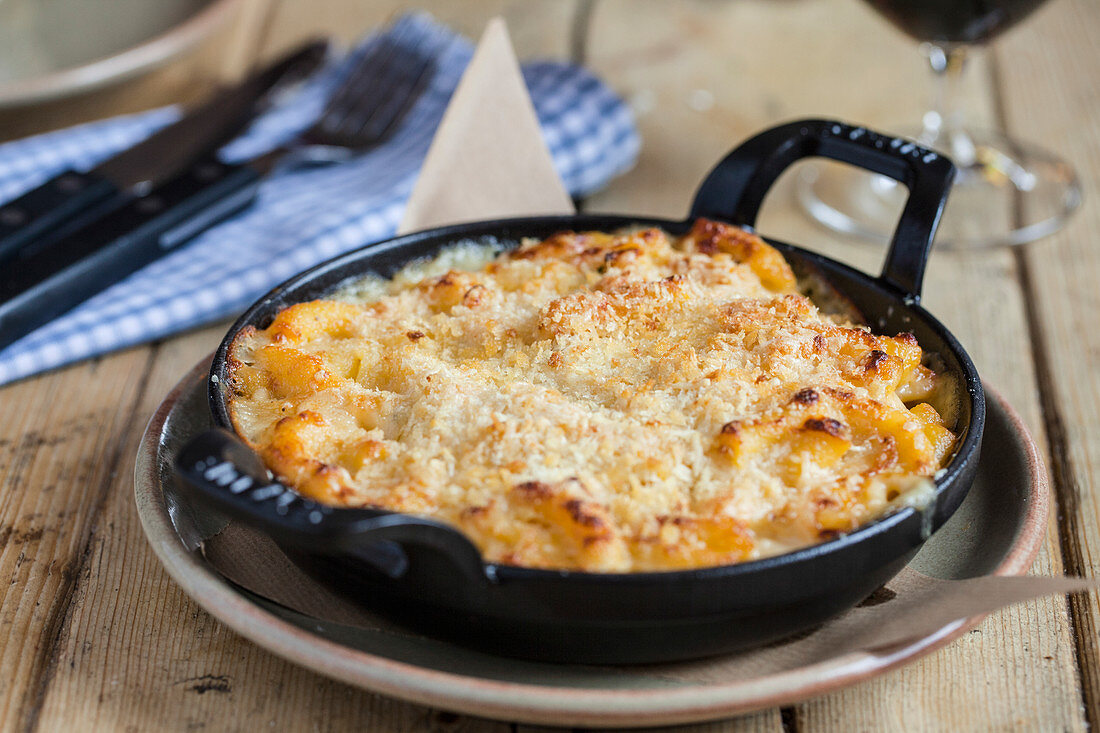 Macaroni Cheese served in a black cast iron dish