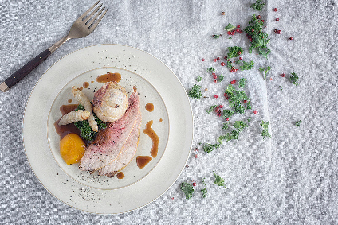 Plate of Pheasant and Seasonal Vegetables on Linen Cloth