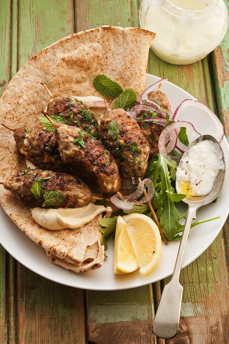 Lamb and pork kebabs with garlic yoghurt